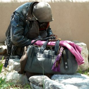 Homeless man goes thru his bag